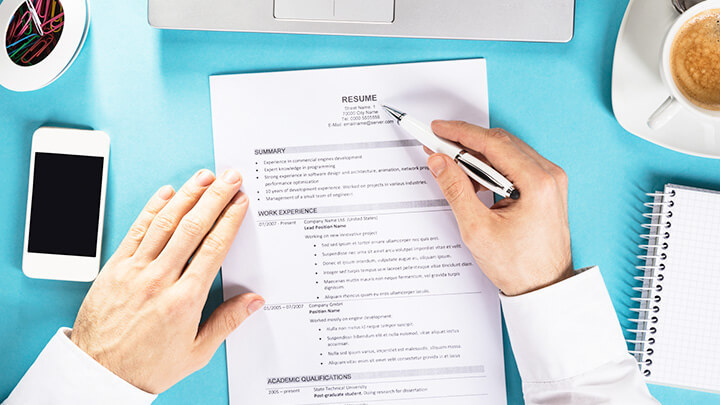 A hand hovering over a cv