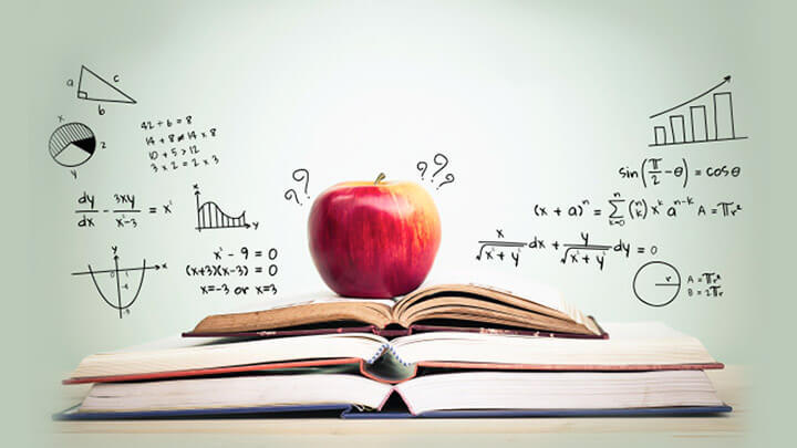 An apple sat on a stack of 3 open books, surrounded by mathematical equations