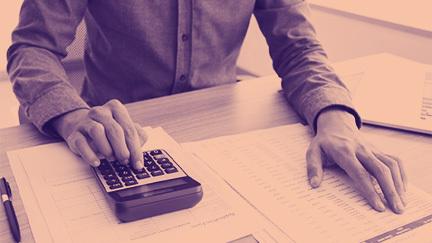 Hand operating a calculator