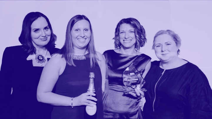 Kaplan employees holding award