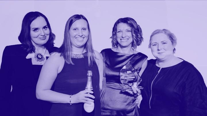 Kaplan employees holding award