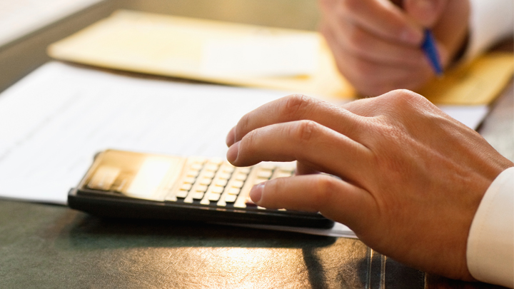 A person using a calculator