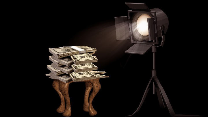 A pile of money under a spotlight