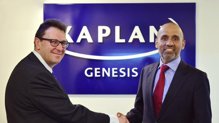 Kaplan UK Chief Executive Officer Peter Houillon shakes the hand of Binod Shankar, Managing Director of Genesis Institute