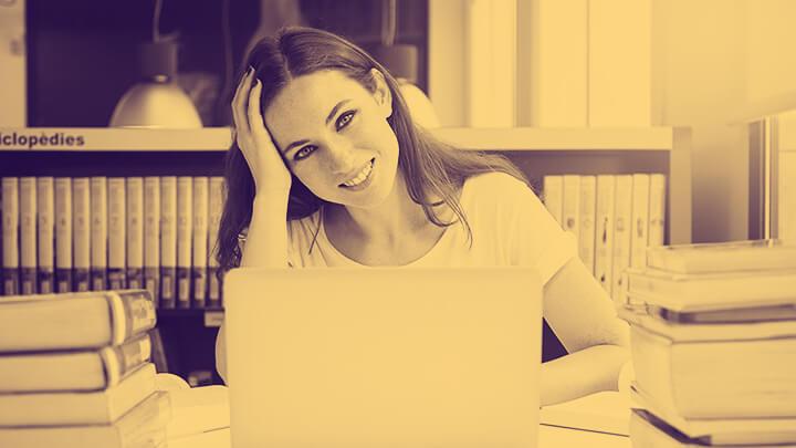 Young female employee, enjoying her work
