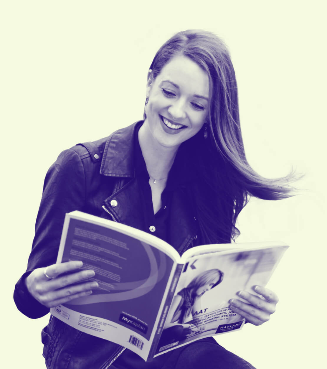 A woman reading a Kaplan Publishing book
