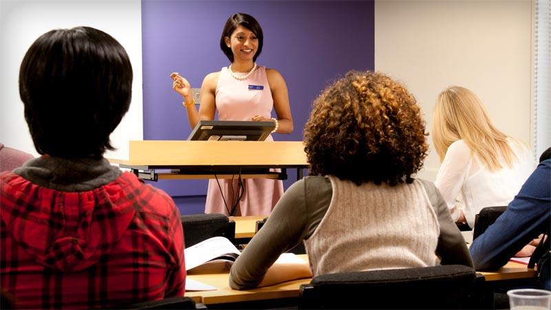 Tutor teaching students in a Kaplan classroom